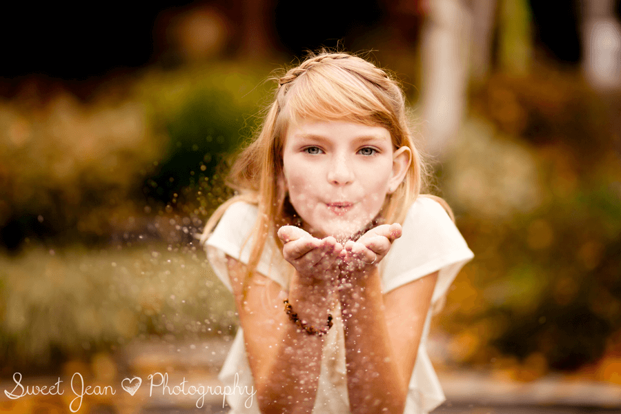GIrl blowing glitter
