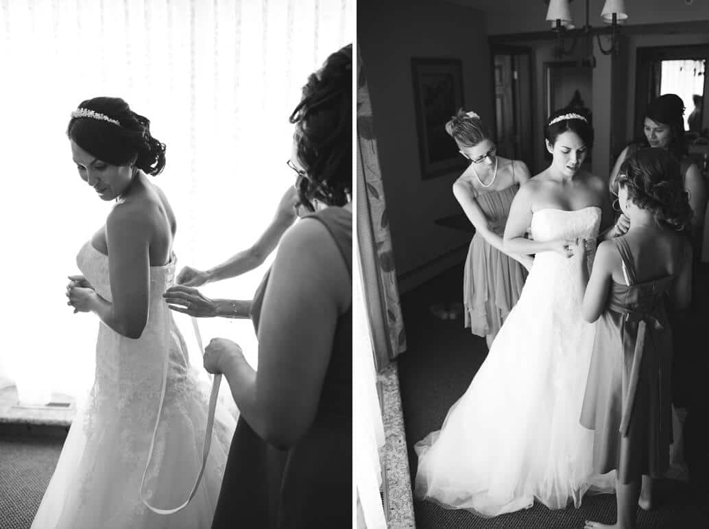 bridesmaids fastening brides dress