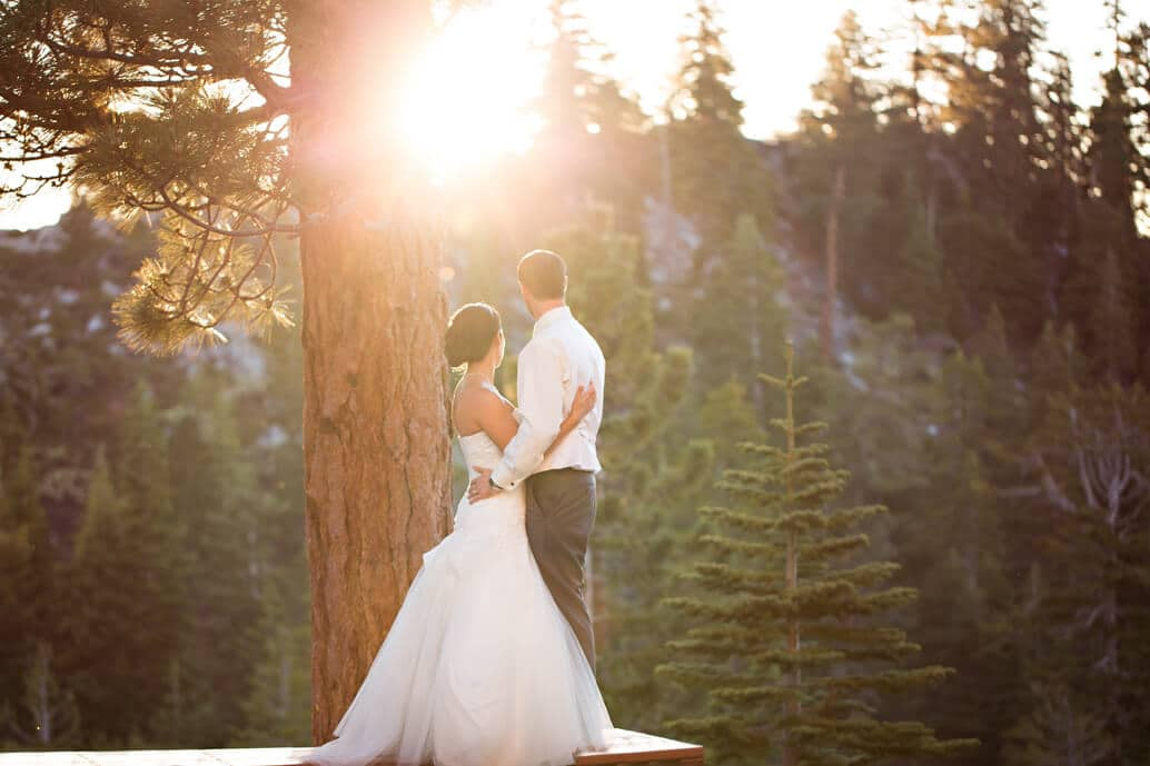 bride and groom gazing into the tahoe sunset