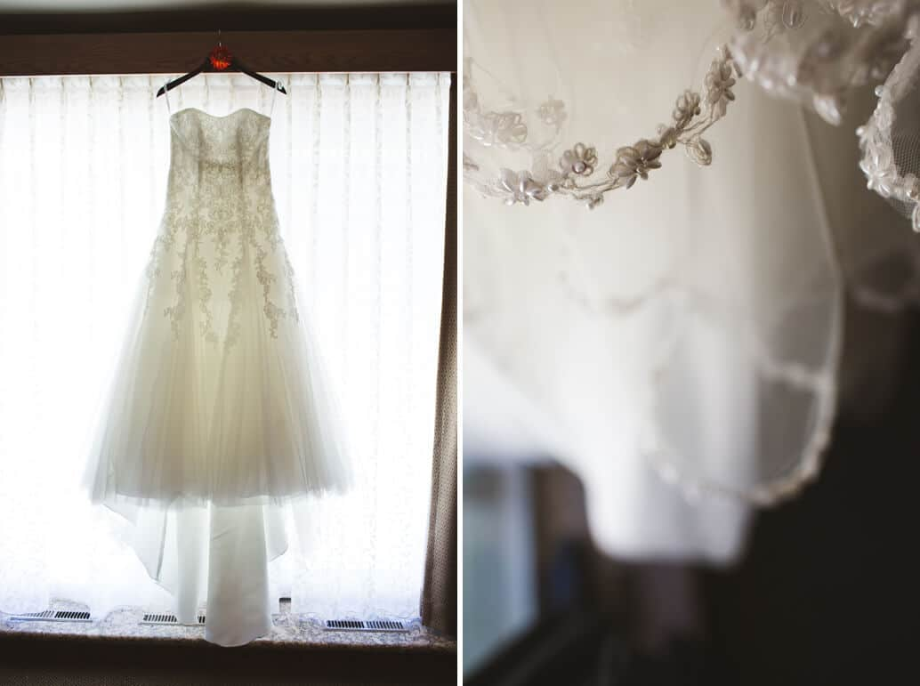wedding dress hanging in window with details