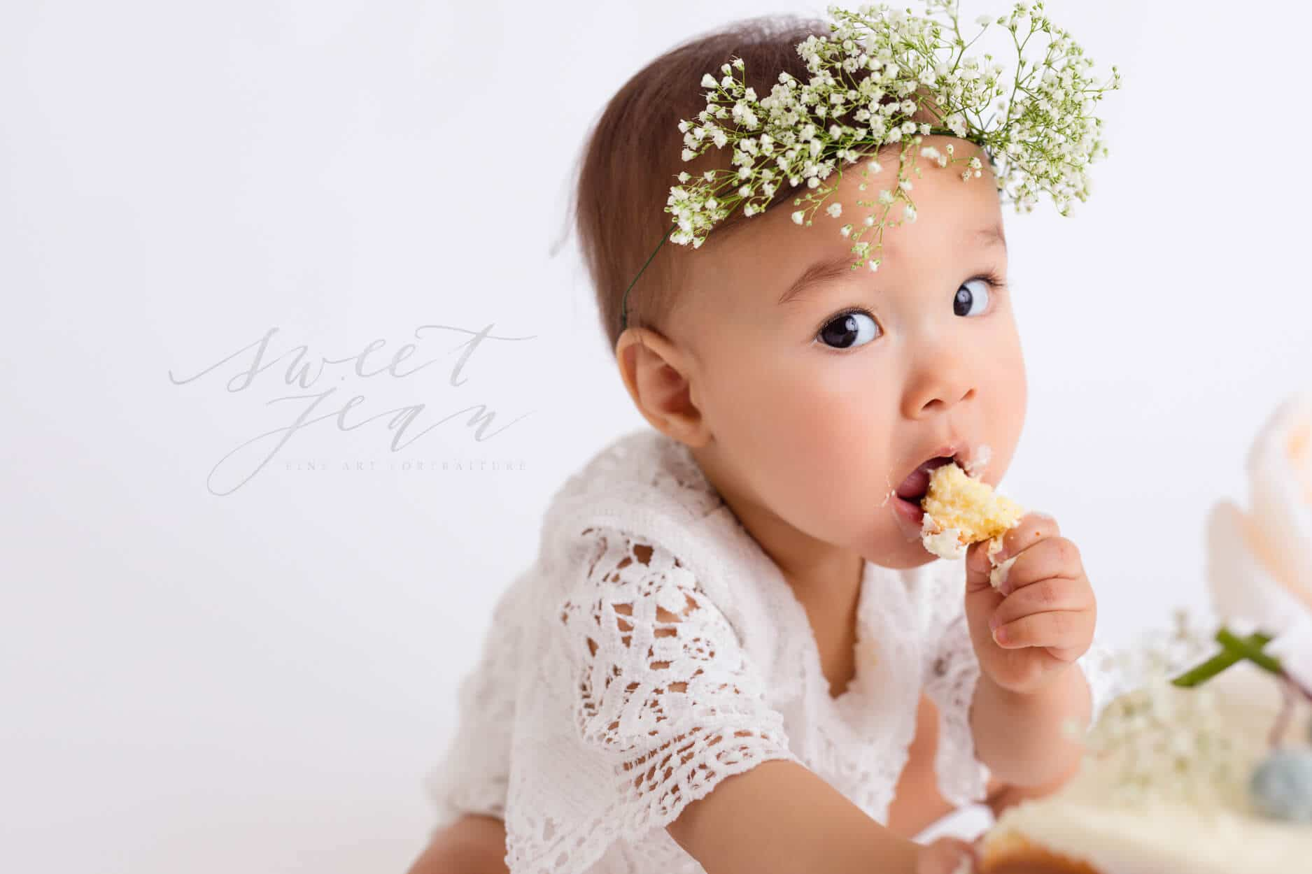 Baby girl eating cake smash session sweet jean photography Sacramento Roseville