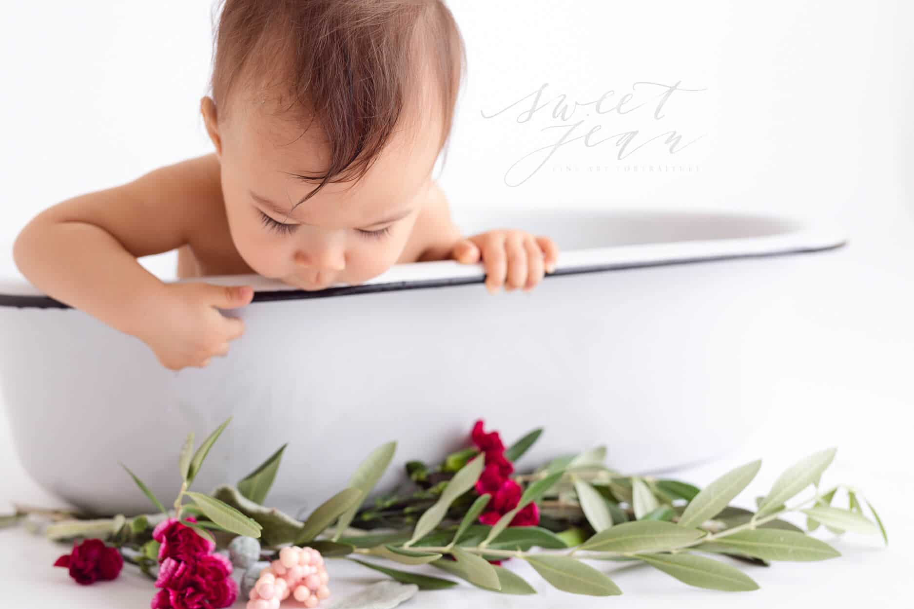 baby looking over edge of vintage enamel tub sweet jean photography Roseville Sacramento