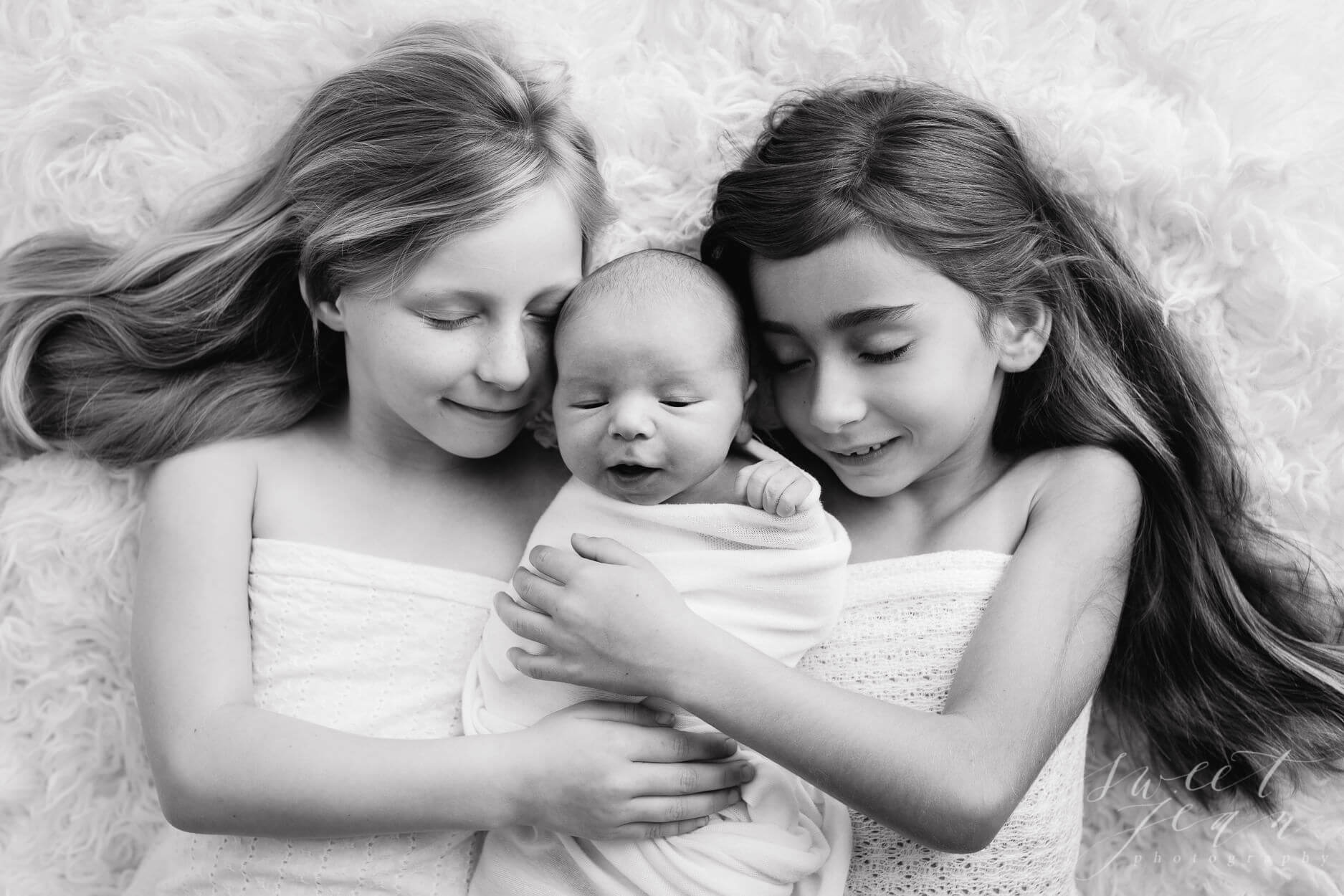 Newborn baby with sisters sweet jean photography roseville ca